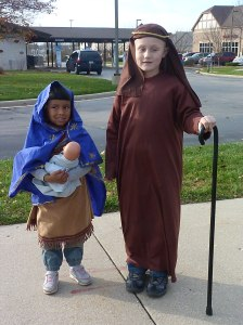 Our Little Holy Family at the Christmas Parade- © SalveMaterDei.com, 2011.